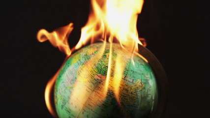 Setting a globe on fire
