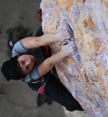 Hands of female climber holding the edge
