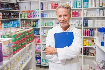 Senior pharmacist holding a clipboard