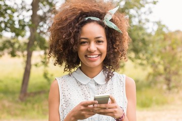 Happy young woman using smartphone