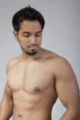 Young and fit male model showing his muscles