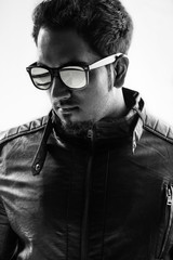 Portrait of a young man in leather jacket with sun glasses