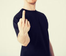 man showing middle finger