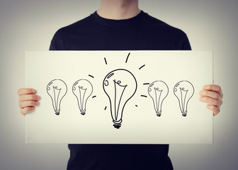 man showing picture with light bulbs