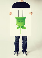 hands holding picture of green electrica ecol plug