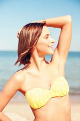 girl posing on the beach