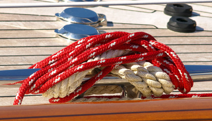 boater's rope attached to cleat on boat