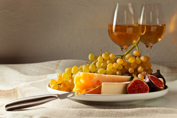 cheese with fruits and sweet wine