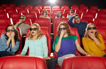 friends watching horror movie in 3d theater