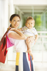 Woman with baby and shopping bags