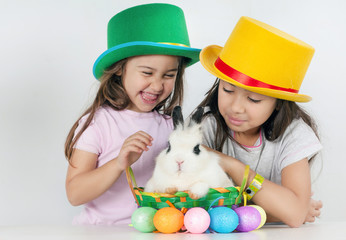Sweet white soft bunny and young girls