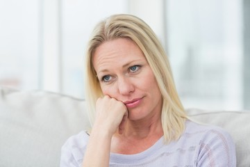 Upset woman in living room