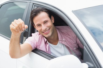 Man smiling and holding key