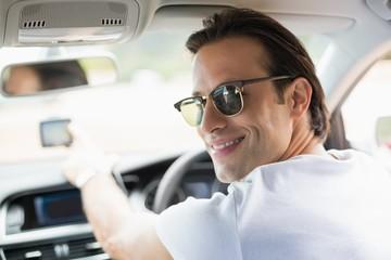 Smiling man using satellite navigation system