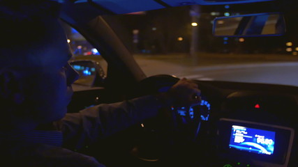 The man drive the car inside view, control panel, wheel