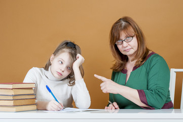 Strict woman teacher points at student..