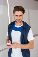 Handsome young man text messaging