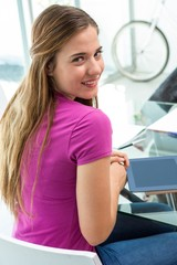 Casual young woman with digital tablet