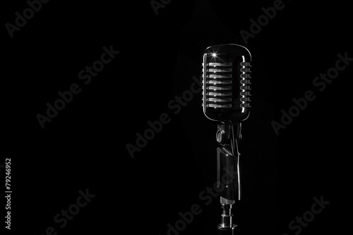 Vintage retro microphone isolated on black background - 79246952