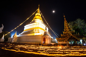 Candle lit in makha bucha day  at Wat Phra That Lampang Laow