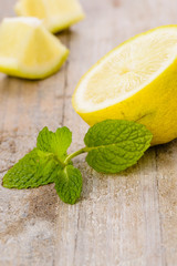 fresh mint and lemon on the wooden board