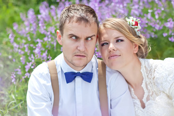 bride and groom in flower garden