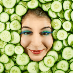 Woman and cucumber