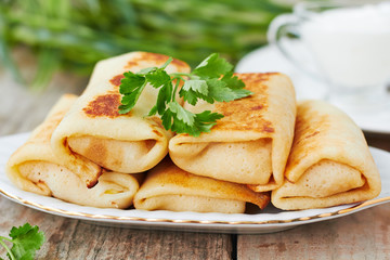 Stuffed pancakes crepes with meat and sauce