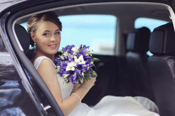 Portrait of the bride at a wedding in a white dress
