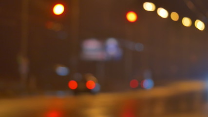 Cars on the road, blurred bokeh background, left-side traffic