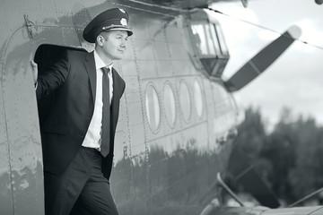 Male pilot a small plane