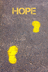 Yellow footsteps on sidewalk towards Hope message