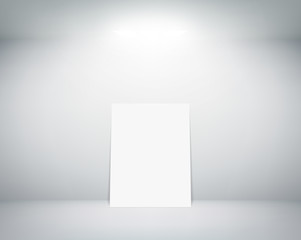 white sheet stands near a wall