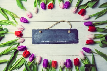 Tulips forming frame around chalkboard