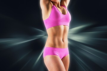 Composite image of fit girl stretching in pink bikini