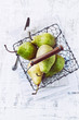 Green pears in a rustic basket