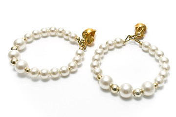 Pearl earrings isolated on white