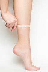 Girl measuring her slim leg