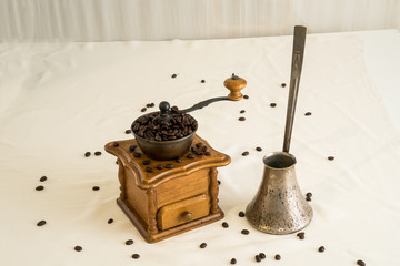 Manual coffee grinder and cezve (ibrik)