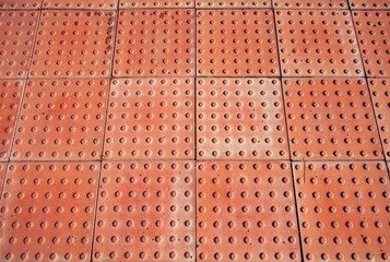 Abstract red pavement, industrial panels texture