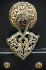 Old copper door knob with Arabic pattern