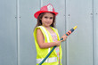 Child girl in fireman costume - 79260353