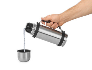 Hand and thermos flask