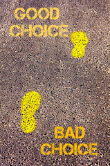 Yellow footsteps on sidewalk.Bad Choice to Good Choice message