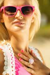 Beautiful blonde girl in sunglasses outdoor