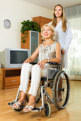 Physician and disabled woman communicating