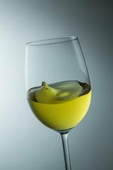 swing glass of white wine