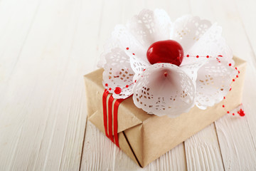 Beautiful gift box on wooden background. Valentine Day concept