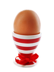 Boiled egg in holder isolated on white