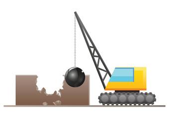 Crane with wrecking ball demolishing a building